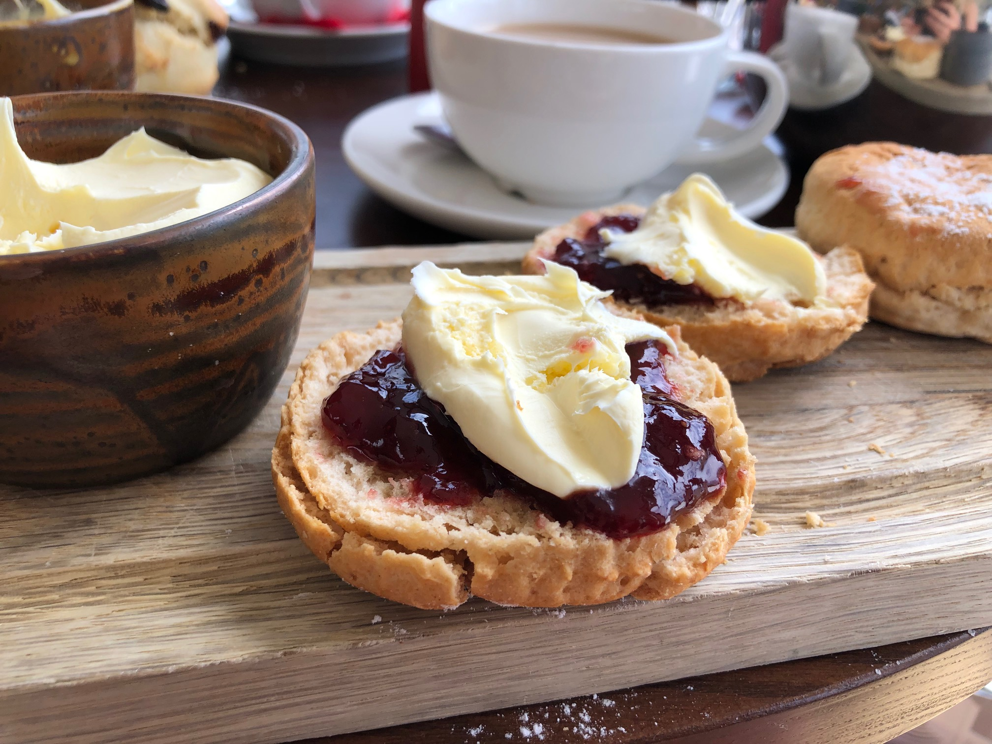 Hommade scone with jam and cream.