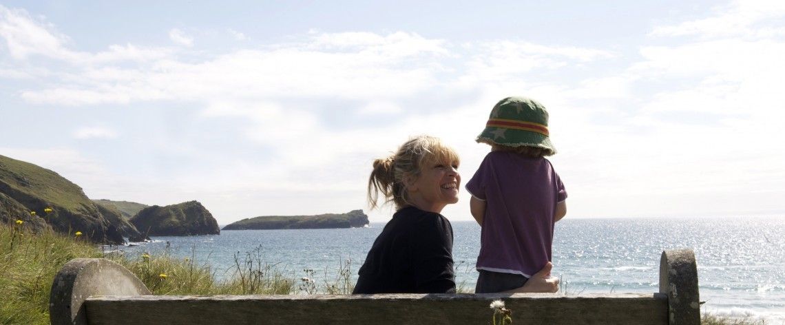 Mother and toddler on the south west coast path at Polurrian Bay