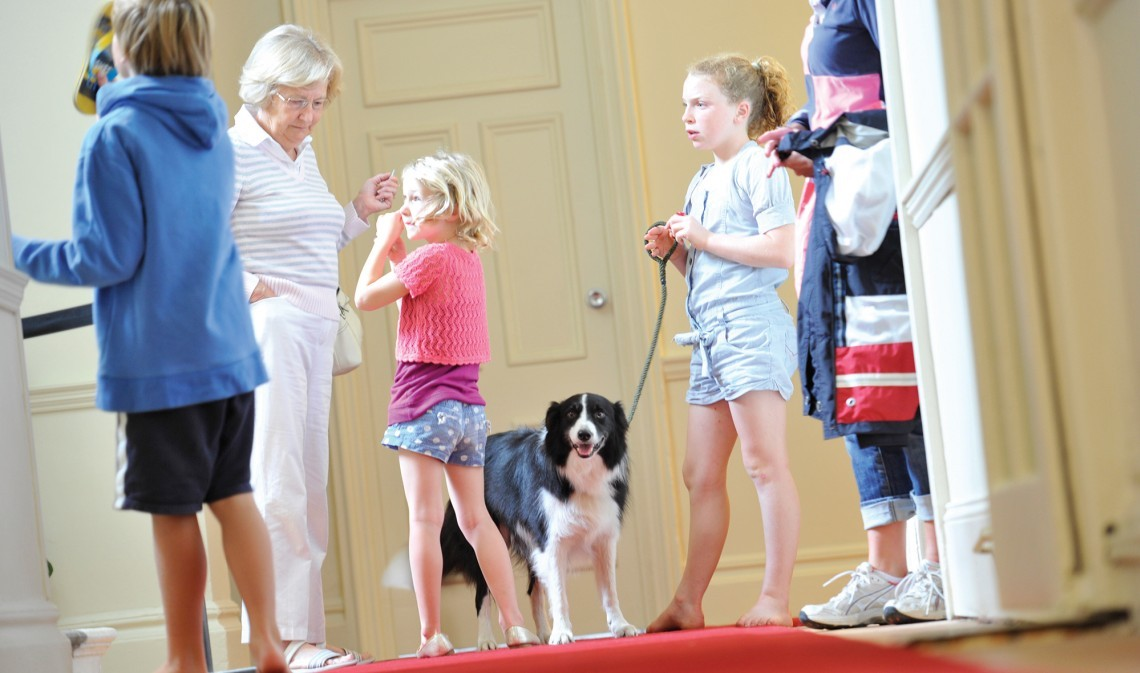 Children with their dog at dog-friendly hotel Polurrian Bay