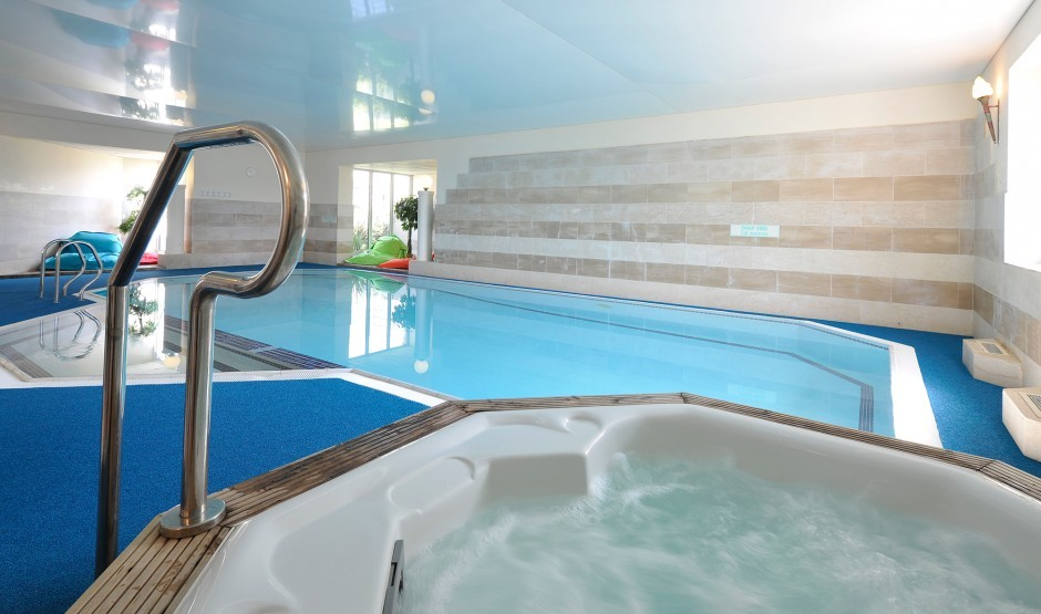 Indoor swimming pool and sauna at luxury hotel Polurrian Bay