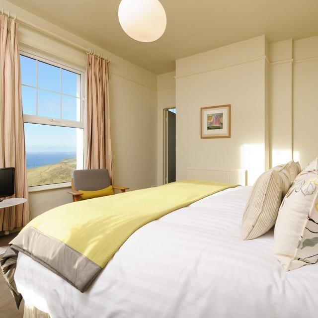A luxurious sea view double room at the Cornish coastal hotel Polurrian Bay