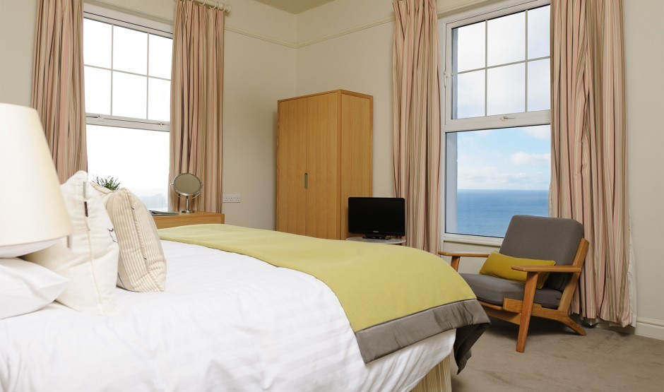 Large bedroom with sea view at a luxury hotel in Cornwall