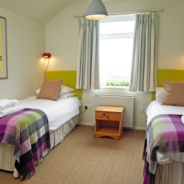 Bedroom at Polurrian Bay Hotel's Cornish holiday cottage