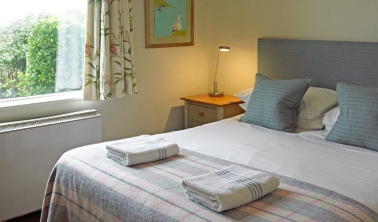 Double bedroom at the Polurrian Bay Hotel self-catering cottage