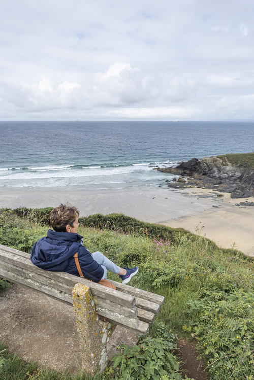 Taking in the view from a bench on the cliff path.